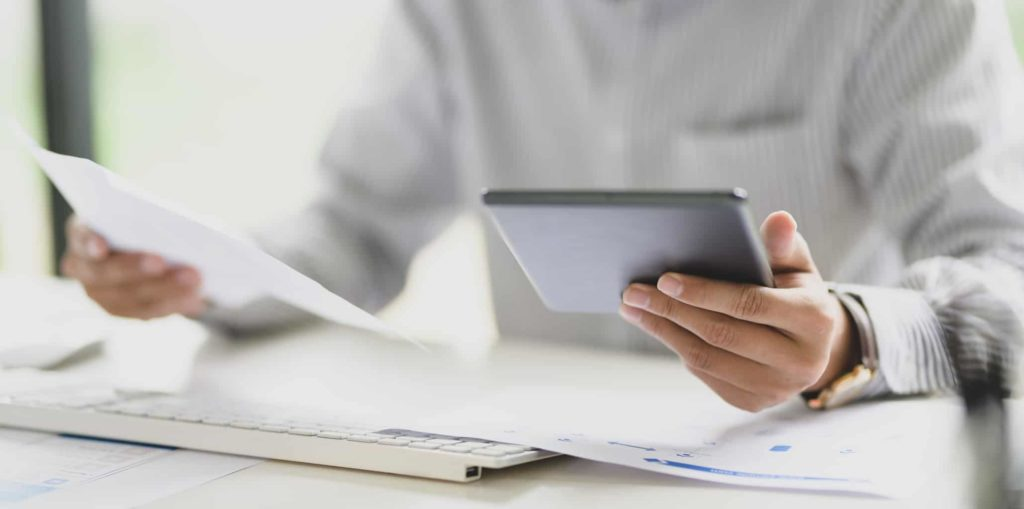 Young businessman working with digital tablet computer ,hands close up